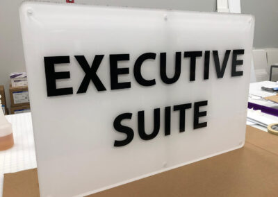 """An acrylic sign that reads """"Executive Suite"""""""