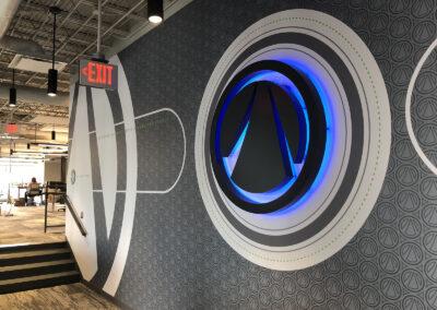 A backlit acrylic logo sign