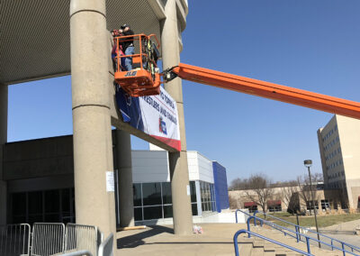 Installation of a banner at the Stormont Vail Events Center