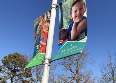 Pole banners showing children discovering and exploring