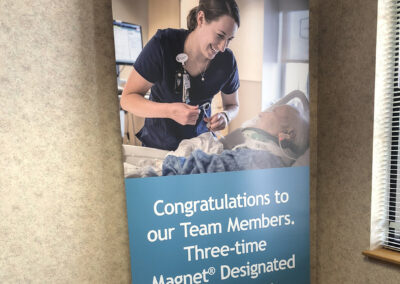 Pop up banner showing a female health care worker helping a patient