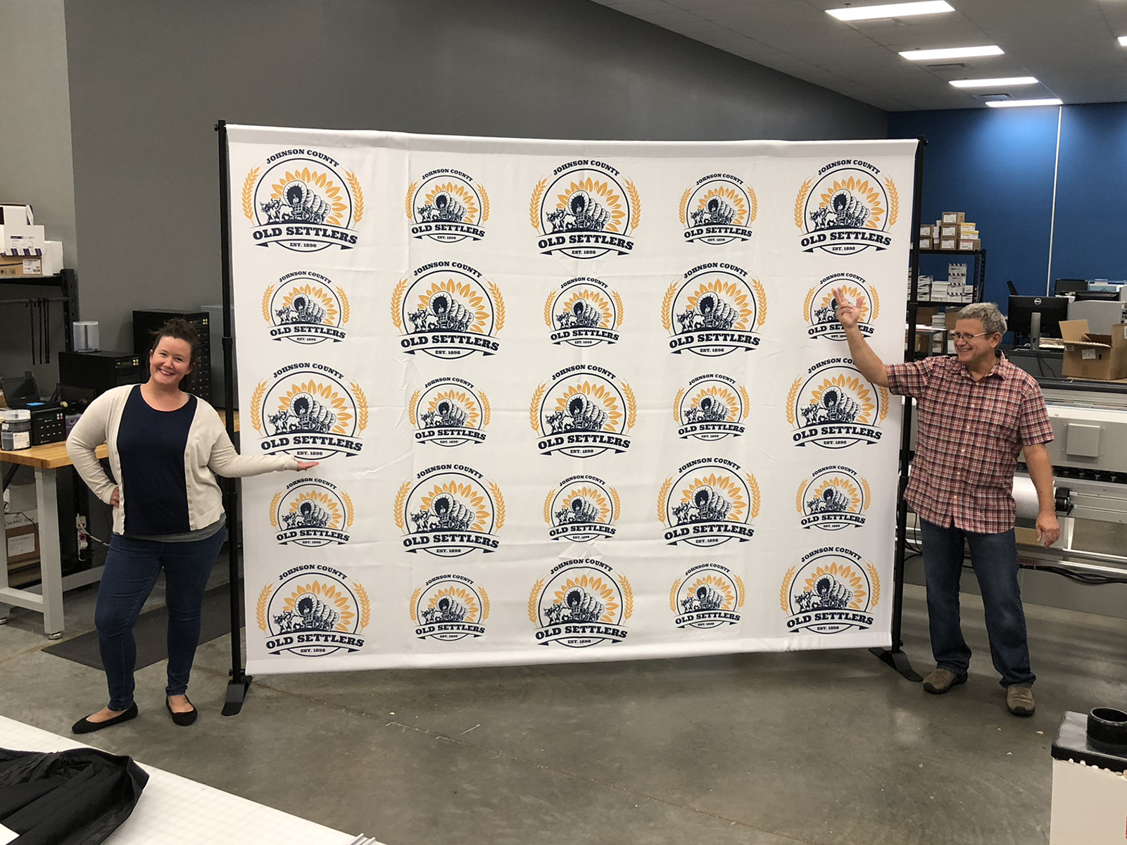 Step and repeat banner backdrop showcasing the logo for Old Settlers Day