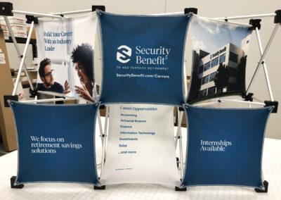 Six-panel geometric tabletop display advertising Security Benefit