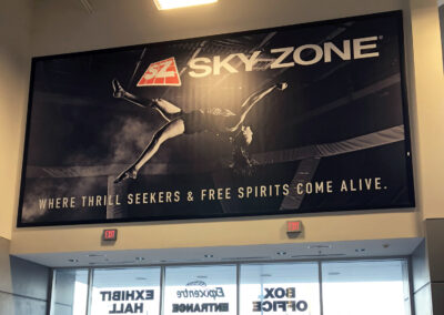 A vinyl snap frame banner advertising Sky Zone at the Stormont Vail Event Center