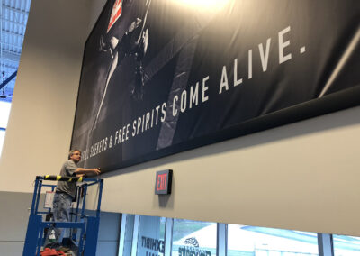 Installation of a vinyl banner at the Stormont Vail Event Center