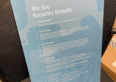 A branded wayfinding sign for the office of Security Benefit